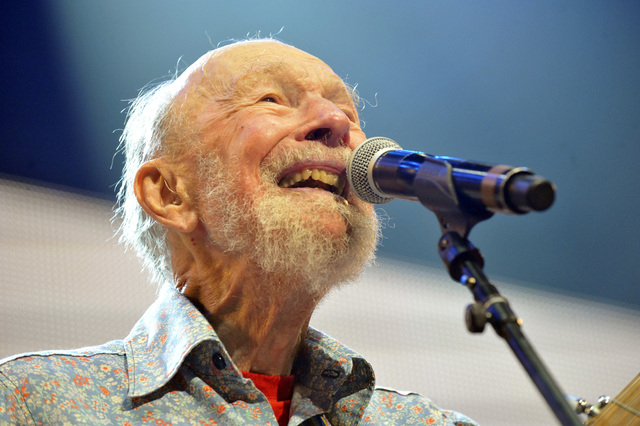 File-This Sept. 21, 2013, file photo shows Pete Seeger performing on stage during the Farm Aid 2013 concert at Saratoga Performing Arts Center in Saratoga Springs, N.Y.   The American troubadour,  ...