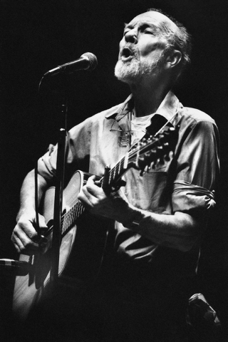 File- This Feb. 25, 1984, file photo shows folk singer Pete Seeger  performing in a one-man benefit concert in Berkeley, Calif., at the Berkeley Community Theater. The American troubadour, folk si ...