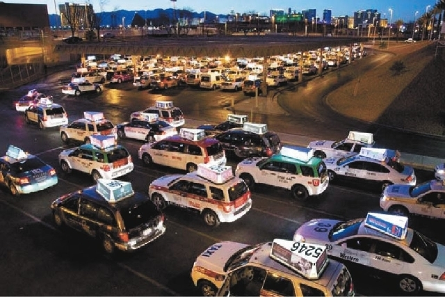 Taxis sit in a waiting bay for their turn to pick up passengers at McCarran International Airport in Las Vegas. (Review-Journal File Photo)