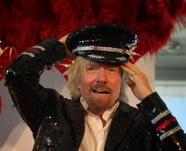 Virgin Group Chairman Richard Branson gets a hat from a showgirl at McCarran airport. He was on hand to celebrate Virgin America's new flights between Las Vegas and Los Angeles. (Jeff Scheid/Las V ...