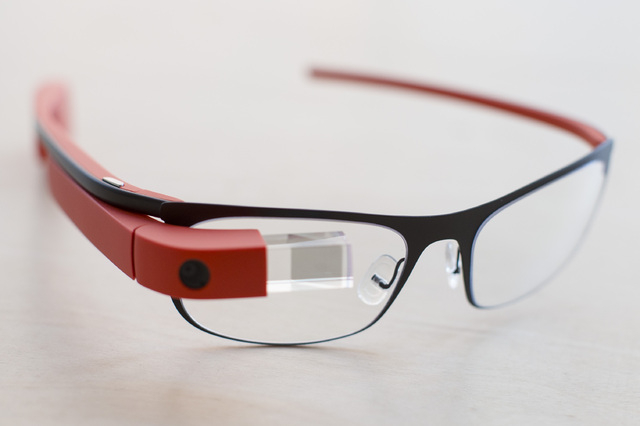 "The new Google Glass ""Thin"" prescription frames in ""tangerine"" color rests on a table at the Google Glass Basecamp space at Chelsea Market, Friday, Jan. 24, 2014, in New York.  ..."