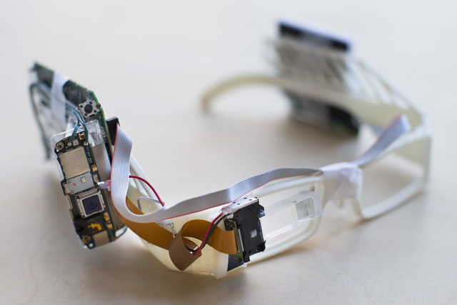 A prototype of Google Glass frames complete with exposed circuit boards and wiring rests on a table at the Google Glass Basecamp space at Chelsea Market, Friday, Jan. 24, 2014, in New York. (AP Ph ...