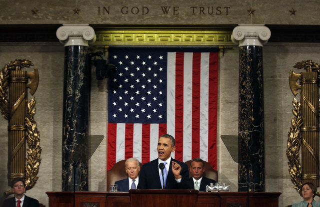 President Barack Obama delivers the State of Union address before a joint session of Congress in the House chamber Tuesday, Jan. 28, 2014, in Washington, as Vice President Joe Biden, and House Spe ...