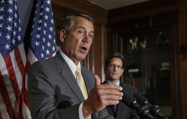 On the day of President Barack Obamas State of the Union address, House Speaker John Boehner of Ohio, left, with House Majority Leader Eric Cantor of Va., talks with reporters at Republican Nation ...