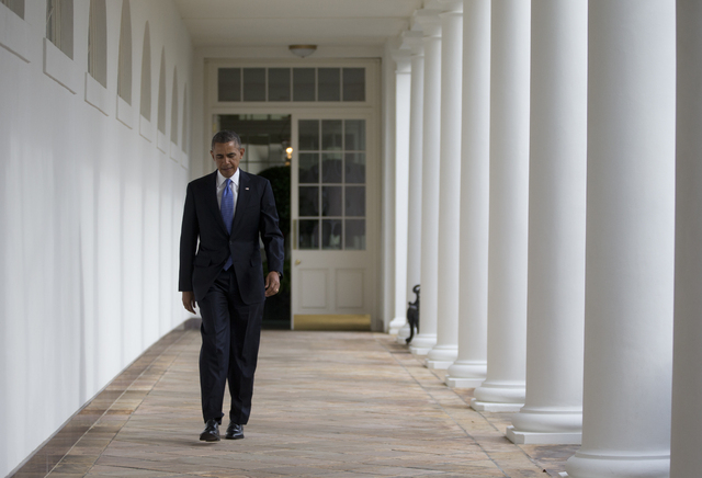 President Barack Obama walks along the Colonnade at the White House in Washington, Tuesday, Jan. 28, 2014, hours before giving his State of the Union Address before a joint session of Congress. (A ...