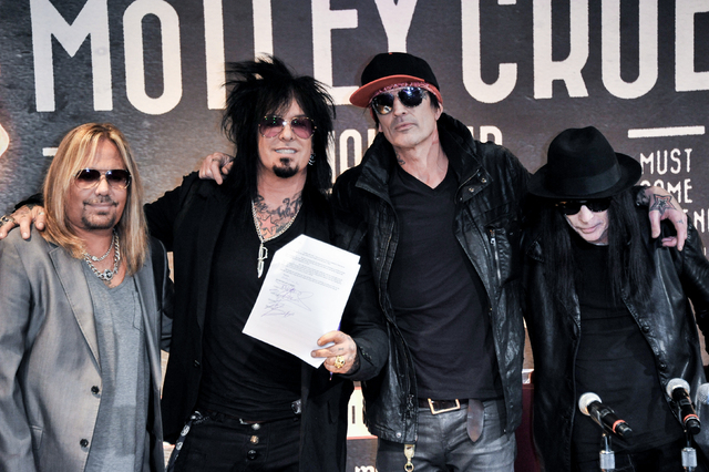 From left,  Vince Neil,Nikki Sixx, Tommy Lee, and Mick Mars seen at Motley Crue Press Conference, Tuesday, Jan. 28, 2014, in Los Angeles. (Photo by Richard Shotwell/Invision/AP)