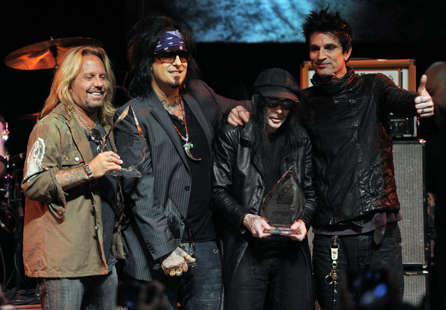 FILE - In this Aug. 18, 2011 file photo, from left, Vince Neil, Nikki Sixx, Mick Mars and Tommy Lee of the band Motley Crue pose together onstage at a tribute to the band to launch the 4th Annual  ...