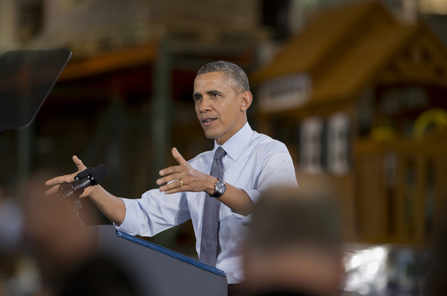 President Barack Obama speaks to Costco employees during a visit to a local Costco in Lanham, Md., Wednesday, Jan. 29, 2014. The president is promoting his newly unveiled plans to boost wages for  ...