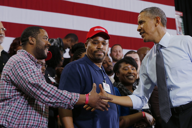 President Barack Obama greets employees at a Costco store in Lanham, Md., Wednesday, Jan. 29, 2104, after he spoke about raising the minimum wage. The president is promoting his newly unveiled pla ...