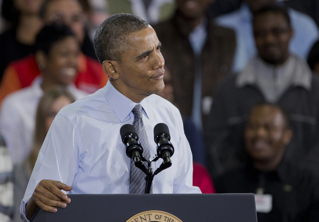 President Barack Obama makes a face as he speaks to Costco employees during a visit to a local Costco in Lanham, Md., Wednesday, Jan. 29, 2014. The president is promoting his newly unveiled plans  ...