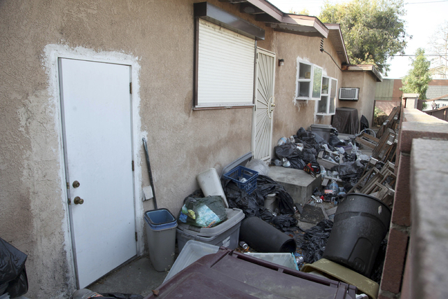 Trash is shown stacked against the home of William Buchman Wednesday Jan. 29, 2014 in Santa Ana, Calif. Buchman has  been arrested for investigation of neglect in the care of animals, after author ...