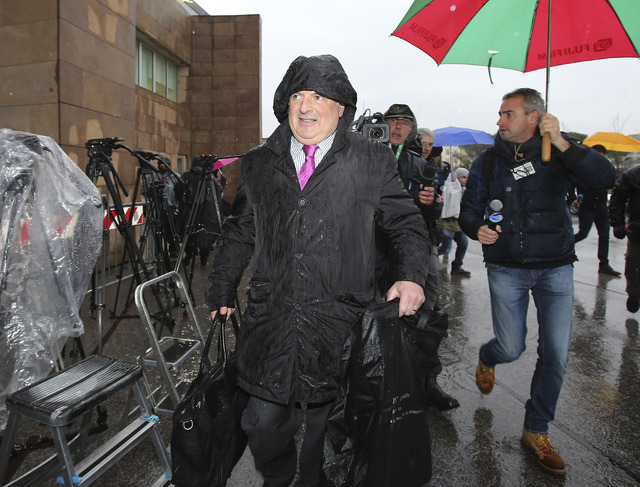 Raffaele Sollecito lawyer Luca Maori arrives for the final hearing before the third court verdict for the murder of British student Meredith Kercher, in Florence, Italy, Thursday, Jan. 30, 2014.   ...
