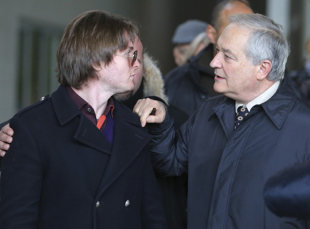 Raffaele Sollecito, left, and his father Francesco leave after attending the final hearing before the third court verdict for the murder of British student Meredith Kercher, in Florence, Italy, Th ...