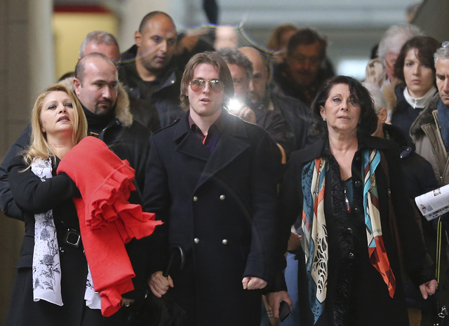 Raffaele Sollecito is flanked by his stepmother, Mara Papagni, left, and his aunt Sara Achille, right, as he leaves the final hearing before the third court verdict for the murder of British stude ...