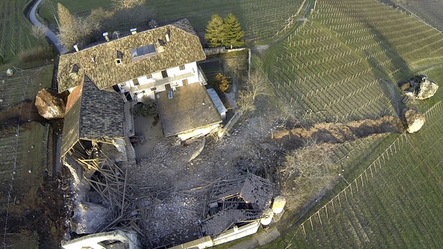 In this photo provided by Tareom.com Thursday, Jan. 30, 2014, and taken on Jan. 23, 2014, a huge boulder is seen after it missed a farm house by less than a meter, destroying the barn, and stopped ...