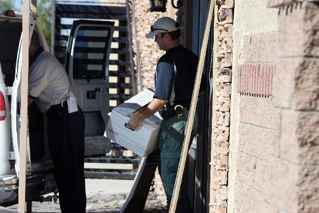 FBI agents load boxes of records seized from Benzer's, a business that was set up by Leon Benzer in southwest Las Vegas, in September 2008. Benzer is at the center of a long-running criminal inve ...