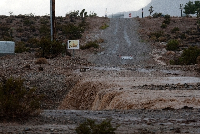 A flooded portion of Kyle Canyon Road near Mount Charleston is shown in this September file photo. Heavy rains forced closure of the road. (Jessica Ebelhar/Las Vegas Review-Journal)