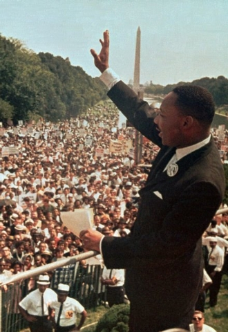 The Rev. Martin Luther King Jr. waves to the crowd at the Lincoln Memorial on Aug. 28, 1963.  (AP Photo/File)