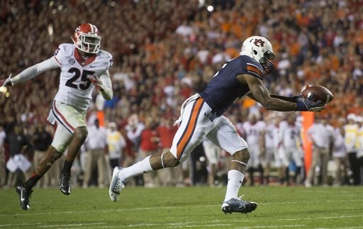 Auburn wide receiver Ricardo Louis (5) makes the catch the to score the game-winning touchdown as Georgia strong safety Josh Harvey-Clemons (25) looks on late in the fourth quarter of an NCAA coll ...
