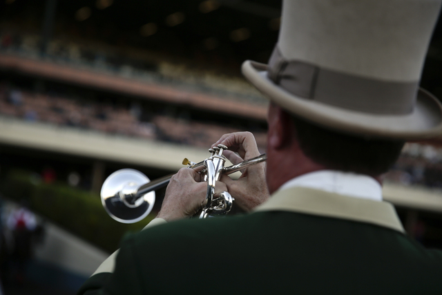 Hollywood Park bugler Jay Cohen, who has been working at the track since 1988, plays the call to the post prior to a race at Betfair Hollywood Park on Saturday, Dec. 14, 2013, in Inglewood, Calif. ...