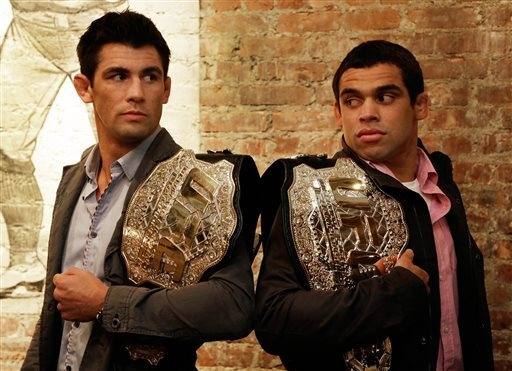 Dominick Cruz, left, from San Diego, and Renan Barao, right, from Rio de Janeiro, pose for photos after a news conference in New York on Nov. 20. Cruz announced Monday he had to pull out of a sche ...