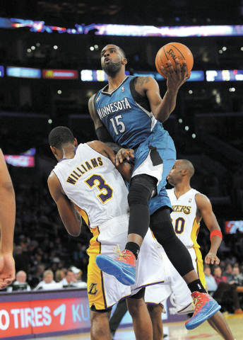 Minnesota Timberwolves forward Shabazz Muhammad, right, puts up a shot as Los Angeles Lakers forward Shawne Williams defends during the second half of an NBA basketball game, Sunday, Nov. 10, 2013 ...