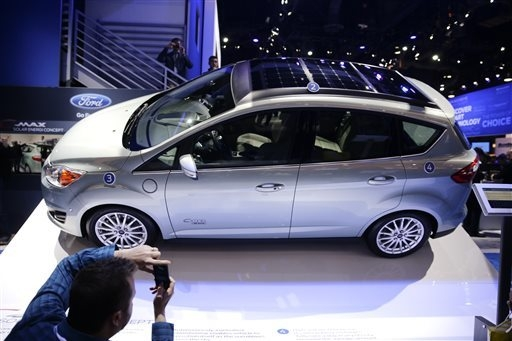 The Ford C-MAX Solar Energi Concept car is unveiled at the International Consumer Electronics Show(CES) on Tuesday, Jan. 7, 2014, in Las Vegas. (AP Photo/Jae C. Hong)