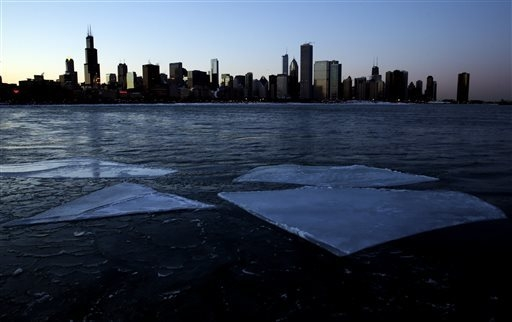 The Chicago skyline and ice floating on Lake Michigan are seen during sunset from the Museum Campus in Chicago on Thursday. (AP Photo/Nam Y. Huh)