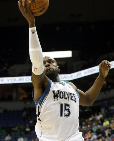 Minnesota Timberwolves' Shabazz Muhammad pulls in a rebound in the second half of an NBA basketball game against the Cleveland Cavaliers, Wednesday, Nov. 13, 2013, in Minneapolis. The Timberwolves ...