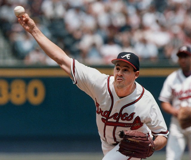 Atlanta Braves pitcher Greg Maddux throws to the plate during the first inning against the Colorado Rockies in Atlanta, Sunday, April 26, 1998. (AP Photo/John Bazemore)