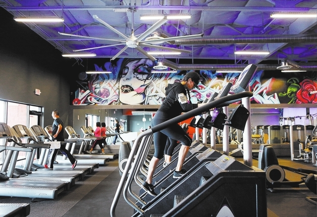 Evelyn Zavala, center, climbs stairs during a workout at Edge Fitness. (Ronda Churchill/Las Vegas Review-Journal)