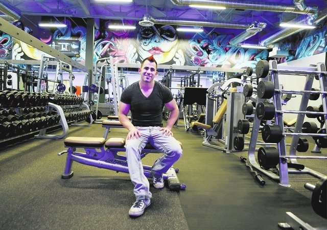 Chris Francy, owner of Edge Fitness, sits in the free weights area at Edge Fitness. (Ronda Churchill/Las Vegas Review-Journal)