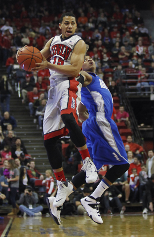 UNLV's Kendall Smith (15) snags a loose ball against the Air Force Academy's Tre' Coggins (1) during their basketball game at the Thomas & Mack Center in Las Vegas on Jan. 4, 2014. (Jason Bean/Las ...