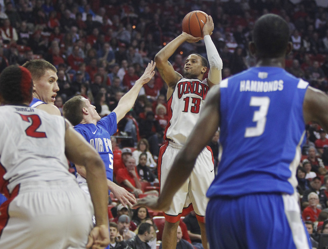 UNLV's Bryce Dejean-Jones (13) shoots over the Air Force Academy's Zach Kocur (5) during their basketball game at the Thomas & Mack Center in Las Vegas on Jan. 4, 2014. (Jason Bean/Las Vegas Revie ...