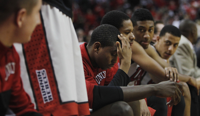 UNLV's Daquan Cook, middle, hangs his head as the Rebels lose to the Air Force Academy at the Thomas & Mack Center in Las Vegas on Jan. 4, 2014. (Jason Bean/Las Vegas Review-Journal)