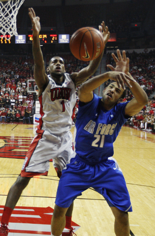 UNLV's Roscoe Smith (1) fights for a rebound against the Air Force Academy's DeLovell Earls (21) during their basketball game at the Thomas & Mack Center in Las Vegas on Jan. 4, 2014. (Jason Bean/ ...