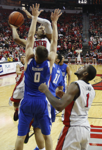UNLV's Bryce Dejean-Jones (13) shoots over the Air Force Academy's Marek Olesinski (0) during their basketball game at the Thomas & Mack Center in Las Vegas on Jan. 4, 2014. (Jason Bean/Las Vegas  ...