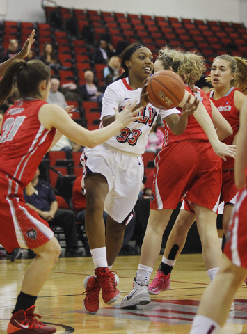 UNLV's Briana Charles (33) looks to pass against New Mexico during their basketball game at the Cox Pavilion on Wednesday. (Jason Bean/Las Vegas Review-Journal)