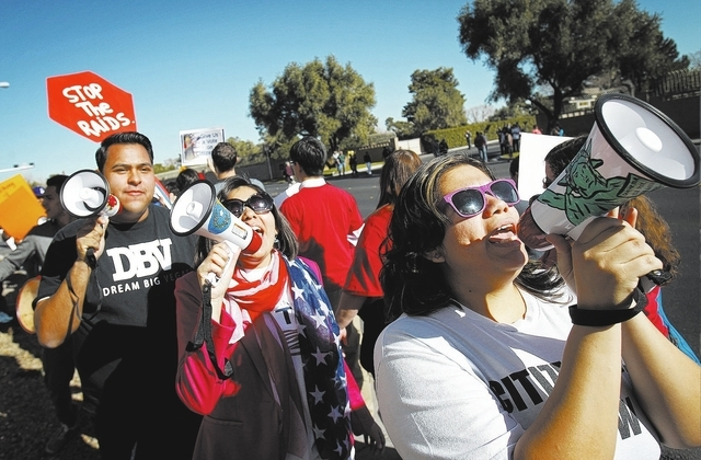 Astrid Silva, right, of the Progressive Leadership Alliance of Nevada  and Blanca Gomez, walking behind her, chant during a protest outside of a fundraiser for U.S. Rep. Joe Heck in Las Vegas Frid ...