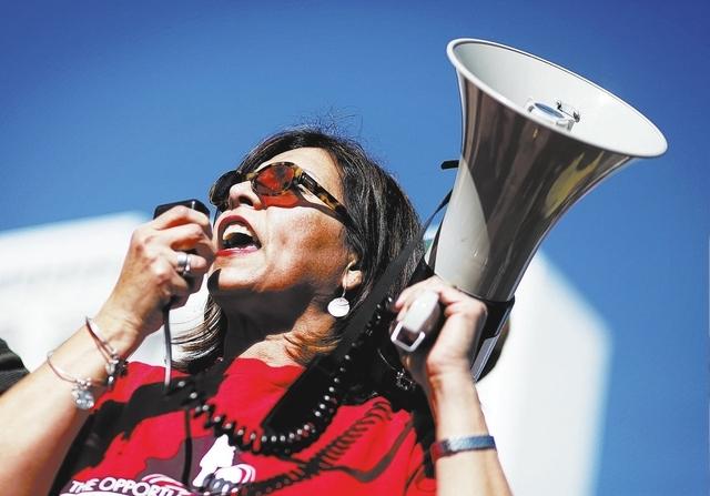 Culinary union Secretary-Treasurer Geoconda Arguello Kline speaks during a protest outside of a fundraiser for U.S. Rep. Joe Heck in Las Vegas Friday, Jan. 17, 2014. GOP House Speaker John Boehner ...
