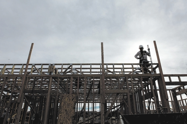 Workers frame a home at the Inspirada master planned community in Henderson, Nev. Tuesday, Jan. 7, 2014. (John Locher/Las Vegas Review-Journal)