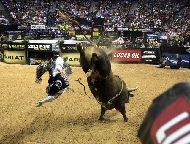 Cord McCoy of Tupelo, Okla. gets bucked off Bushwacker after 3.39 seconds during Round 3 of the Professional Bull Riders World Finals Friday, Oct. 28, 2011. (K.M. CANNON/LAS VEGAS REVIEW-JOURNAL)