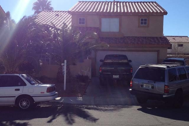 North Las Vegas police responded to a call at 2039 Cardigan Avenue Tuesday night, Jan. 14, 2014. A 49-year-old man was found dead inside the home, which is near Gowan Road and Clayton Street. (Ste ...