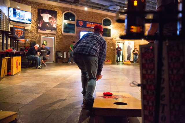 Brad Harper plays cornhole at the Double Yoke, located at 6050 Sky Pointe Drive, Thursday, Jan. 2, 2014. A group of cornhole enthusiasts are moving their regular playing location from La Piazza on ...