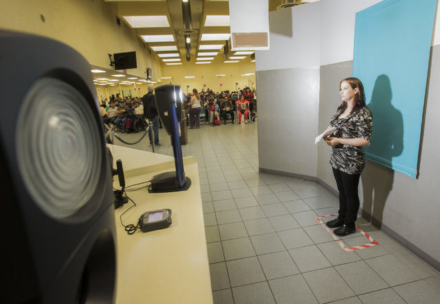 Chandell Lanting gets her photo taken at the Department of Motor Vehicles office, 2701 E. Sahara Avenue on Friday, Jan. 17, 2014. The DMV conducts facial recognition in one secure facility.  Each  ...