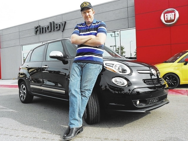Courtesy photo Longtime Las Vegan Mike Smith stands 6 feet, 5 inches, and he says he fits in his 2014 Fiat 500 L just fine.
