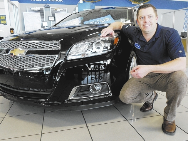 "Courtesy photo  Findlay Chevrolet sales manager Doug Fleming touts the ""Never Ending Warranty"" at the dealership in the southwest valley."