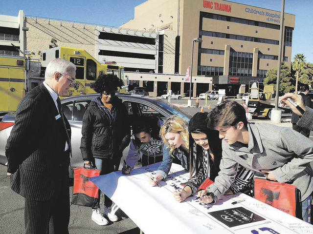 "Students participate in the ""You Drink, You Drive, You Lose"" event last month at University Medical Center."