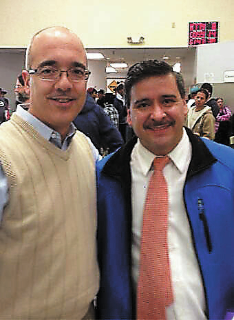 State Sen. Mo Denis, left, poses with Armando Quezada Friday, Jan. 3, 2014, at the Department of Motor Vehicles' office at 2701 E. Sahara Ave. after Quezada completed the process to apply f ...