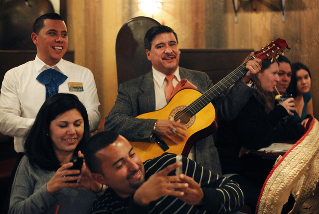 Armando Quezada, middle, plays music during a birthday celebration at Lindo Michoacan mexican restaurant in Las Vegas on Friday, Jan. 3, 2014. Quezada is one of the first persons in Las Vegas to f ...